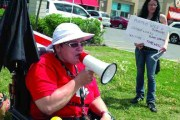 Kathleen Fortin, a member of the ACORN Ottawa executive shouts opposition to clawbacks during a protest to raise social assistance cheques in line with the cost of living at the Food Basics on Merivale Road on May 24.