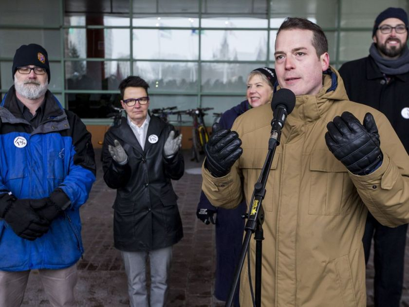 City councillors Jeff Leiper, Catherine McKenney, Theresa Kavanagh, Mathieu Fleury, and Shawn Menard attend a rally for affordable housing outside of Ottawa City Hall before City Council met to discuss budget 2019 on February 6, 2019. Several of the councillors are wearing a 1% button symbolic of the amount they are asking a levy to amount to in the budget. The rally was organized by ACORN and 6 other community groups demanding affordable housing
